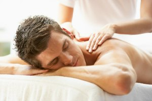 man receiving a massage therapy session